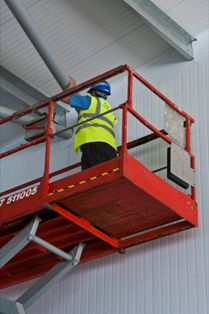 Image: Worker in scissor lift